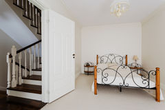 Simple bedroom and wooden stairs Stock Photography