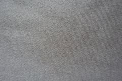Simple beige jersey fabric from above. Simple unprinted beige jersey fabric from above Stock Photography