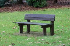 Simple bench in a park Stock Photos