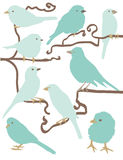 Simple bird illustrations. Group of simply illustrated birds perching on branches. Each bird is on its own layer. All branches are on same layer. Very easy to royalty free illustration