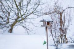 Simple birdhouse in winter garden stock image