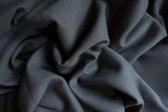 Simple black fabric in soft folds. Simple black viscose fabric in soft folds Stock Photos