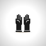 Simple black icon of pair latex gloves. Stock Images