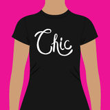 Simple Black Shirt Template with Chic Text. Simple Black Woman Shirt Template with White Chic Text In Front, Isolated on a Pink Background Royalty Free Stock Images