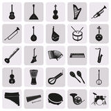 Simple black silhouettes of musical instruments. Collection of simple black silhouettes of musical instruments Royalty Free Stock Photos
