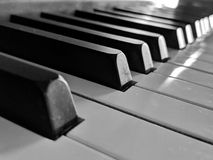 Simple Black and White piano keys background. Simple Angled perspective of this percussion instrument stock photos