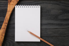 Simple blank notepad on rustic wood table Stock Photos