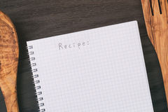 Simple blank notepad with word recipe on rustic wood table Royalty Free Stock Photo