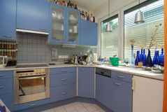 Simple blue kitchen. Picture of a simple modern kitchen Stock Photography