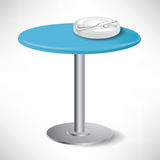 Simple blue round table with plates Stock Photo