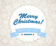 Simple blue vintage retro Christmas card. With snowflakes on the background Royalty Free Stock Photo