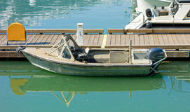 A simple boat tied to a floating dock in alaska Royalty Free Stock Photo