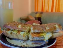 Simple Bread—Egg Breakfast. A simple egg sandwich, with juice and some really good light Royalty Free Stock Photography