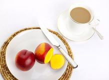 Simple Breakfast. Of nectarines and coffee, white linen cloth Stock Images