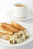 Simple breakfast. The toast, feta cheese with herbs and the cup of coffee. The sharpness on blocks of cheese stock image