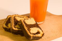 Simple breakfast chocolate roll with carrot juice Stock Photo