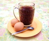 Simple breakfast of coffee and eggs Stock Photos