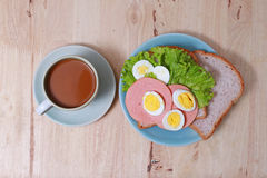 Simple breakfast with egg sandwich and coffee Royalty Free Stock Images