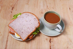 Simple breakfast with egg sandwich and coffee Royalty Free Stock Photo