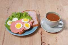 Simple breakfast with egg sandwich and coffee Stock Images