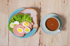 Simple breakfast with egg sandwich and coffee Stock Photography