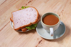 Simple breakfast with egg sandwich and coffee Stock Photos