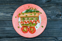 Simple breakfast. Sausage sandwich snack and vegetables on whole Royalty Free Stock Photo