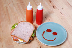 Simple breakfast with smile face on dish Stock Images