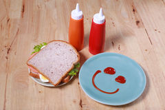 Simple breakfast with smile face on dish Royalty Free Stock Image