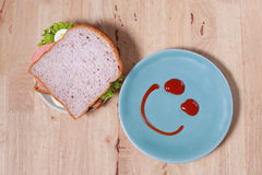 Simple breakfast with smile face on dish Stock Photography