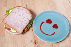 Simple breakfast with smile face on dish Royalty Free Stock Photos