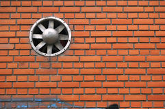 Simple brick wall with a ventilation hole. Simple brick wall with a ventilation propeller stock photo