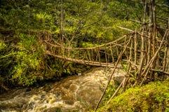 Simple bridge near wamena. Photo of simple wooden bridge over floating river in rich greenery of Dani circuit near Wamena, Papua, Indonesia Royalty Free Stock Images
