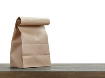 Simple brown paper bag for lunch or food on wooden Royalty Free Stock Photo
