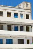 Simple building on Malta. Simple building with windows, doors and balconies in the style of constructivism on Malta Royalty Free Stock Photo