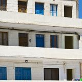 Simple building on Malta. Simple building with windows, doors and balconies in the style of constructivism on Malta Stock Photography