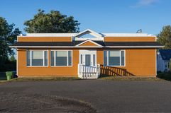 Simple bungalow house. With a flat roof Stock Images