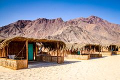 Simple bungalow style shacks at a desert beach resort in Nuweiba on the Red Sea coast of Egypt`s Sinai Peninsula royalty free stock photos