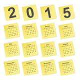 Simple calendar 2015 year on yellow stick notes. Royalty Free Stock Photography
