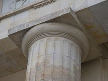 Simple capital on a fluted marble column Stock Image
