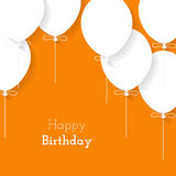 Simple card for birthday with a white paper balloons on orange b Royalty Free Stock Images