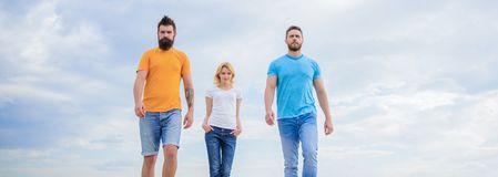 Simple casual must haves. Group of people in casual wear. Pretty woman and men friends walking outdoor. Young people in royalty free stock images