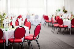 Simple catering in tent reception, red chairs, white background royalty free stock photo