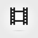 Simple celluloid film black icon. Concept of footage, 35 mm format, television, cinematography, film roll, slide. isolated on grey background. flat style Royalty Free Stock Images