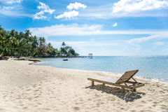 Simple chair and beach scene with blue sky Royalty Free Stock Photo