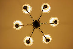 Simple chandelier bottom view with green ceiling Royalty Free Stock Images
