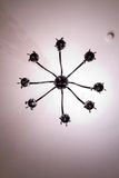Simple chandelier bottom view with white ceiling background Stock Photo