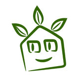 Cute smiling eco home logo. Vector cute smiling eco home logo in green Royalty Free Stock Image