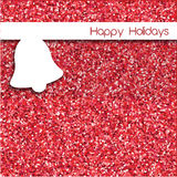 Simple Christmas card design with bell over red glitter backgrou Stock Photos