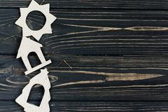 Simple christmas eco toys on stylish black wooden background in Stock Image